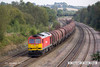 140908-045     DB Schenker class 60 no 60011 passes Hasland with 6E08, 13.03 Wolverhampton steel terminal to Immingham sorting sidings.