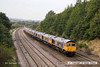140908-060     GB Railfreight locomotive convoy 0X66, 10.45 Newport docks to Doncaster, Roberts Road is captured heading away from the camera as it passes Hasland, Chesterfield on Monday 8th September 2014. Class 66/7 no 66753 is seen hauling nine new classmates no's (in order, from the front) 66757, 66758, 66765, 66759, 66760, 66762, 66761, 66764 & 66763. The four at the rear, no's 66761 - 66764 were deposited at Barrow Hill en-route to Doncaster.