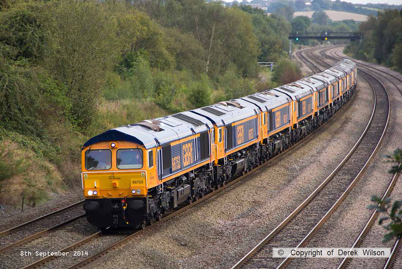 140908-050     GB Railfreight locomotive convoy 0X66, 10.45 Newport docks to Doncaster, Roberts Road is captured passing Hasland, Chesterfield on Monday 8th September 2014. Class 66/7 no 66753 is seen hauling nine new classmates no's (in order, from the front) 66757, 66758, 66765, 66759, 66760, 66762, 66761, 66764 & 66763. The four at the rear, no's 66761 - 66764 were deposited at Barrow Hill en-route to Doncaster.