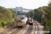 140908-037     Freightliner class 66/6 no 66614 is captured passing Hasland, powering 6M91, 11.13 Theale to Hope, Earles sidings, empty cement tanks. Heading in the opposite direction is a Cross Country Trains Voyager unit with 1v91, the 14.35 Newcastle to Reading.