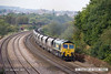 140908-032     Freightliner class 66/5 no 66520 is seen passing Hasland, Chesterfield, powering train 6M51, 12.23 Hull, Kingston terminal to Rugeley power station, loaded coal hoppers.