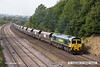 140908-035     Freightliner class 66/5 no 66520 is seen passing Hasland, Chesterfield, powering train 6M51, 12.23 Hull, Kingston terminal to Rugeley power station, loaded coal hoppers.