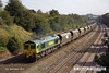 140908-031     Freightliner class 66/5 no 66527 Don Raider is seen passing Hasland, Chesterfield, powering train 4E82, 12.33 Rugeley power station to Barnetby down reception sidings, empty coal hoppers.
