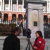 Joel Feldman being interviewed by News 22 in front of the State House