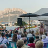 "One of the collateral event of ""Una notte in Italia"" festival: artists talks about their projects with the audience. On the background, island of Tavolara."