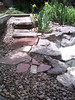 Steps down to pond with the fill rock.