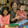 A family enjoys the kid's reading area at RIV.<br /> <br /> Taken on July 4, 2014 by James Cadden.