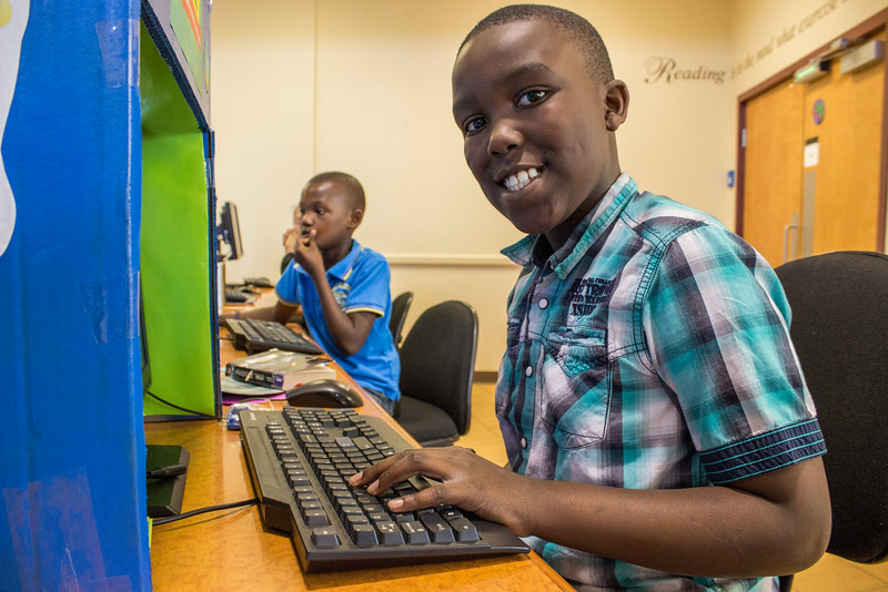 A boy uses the computer at RIV.<br /> <br /> Taken on July 4, 2014 by James Cadden.