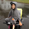 Saya Scott smiles in the rain during a family bike ride from NYC to Niagara Falls and back during summer 2014. The family collected samples for ASC's roadkill project. PHOTO BY CHARLES SCOTT