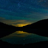 Stars reflect in the still waters of Poudre Lake on Rocky's west side just after midnight.