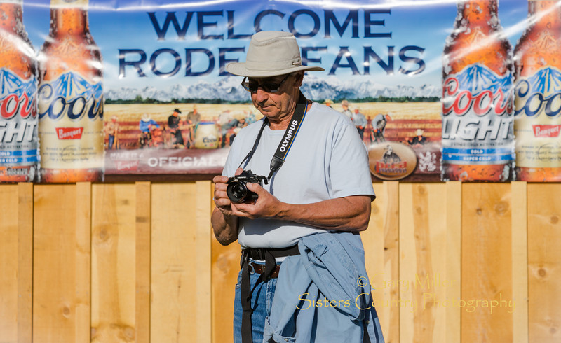 Bill Birnbaum prepares his camera settings for Xtreme Bulls night at the 2014 Sisters Rodeo - Sisters, Oregon © 2014 Gary N. Miller, Sisters Country Photography