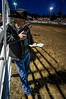 Curt Kallberg managing the chutes during the bullfighting Friday night at the 2014 Sisters Rodeo - Sisters, Oregon © 2014 Gary N. Miller, Sisters Country Photography