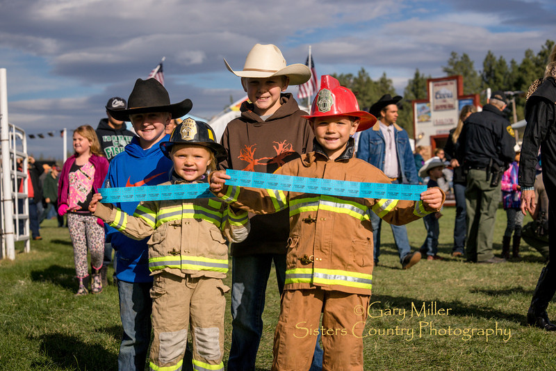 Children of Cloverdale  Fire Department volunteers sell fundraising raffle tickets on Friday night at the 2014 Sisters Rodeo - Sisters, Oregon © 2014 Gary N. Miller, Sisters Country Photography