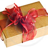 gold gift with red bow isolated