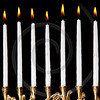 burning hanukkah candles in a menorah