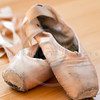 ballet slippers in well-worn condition