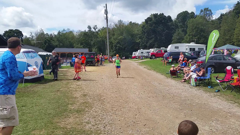 Mary Flaws, female winner of the Hallucination 100 miler, finishing in a time of 21 hours, 30 minutes.