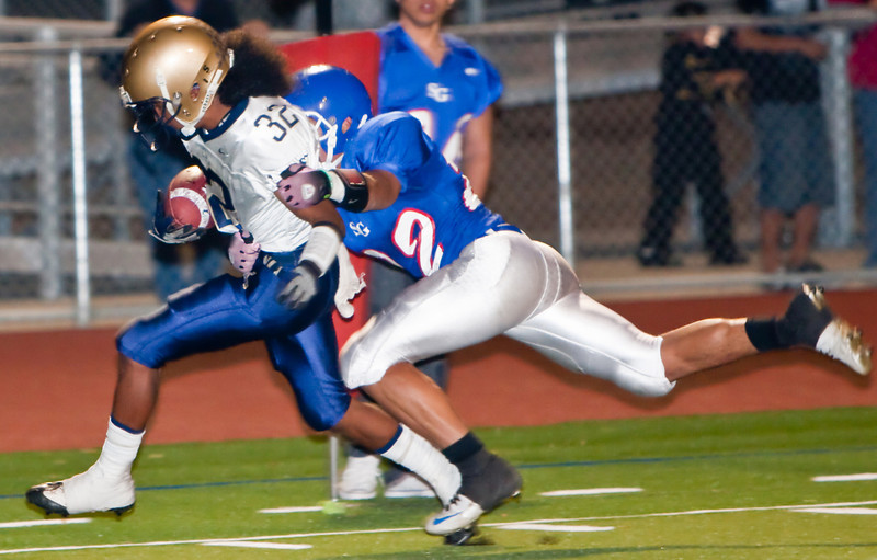 The Moors' Vailele Peko (32) is brought down by the Matadors' Arthur Brown (22) during a football game between the San Gabriel High School Matadors and the visiting Alhambra High School Moors on October 30, 2009  in San Gabriel, CA.  (SGVN/Correspondent photo by David Thomas/SPORTS)