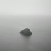 Boulder in misty loch, Isle of Islay, Scotland