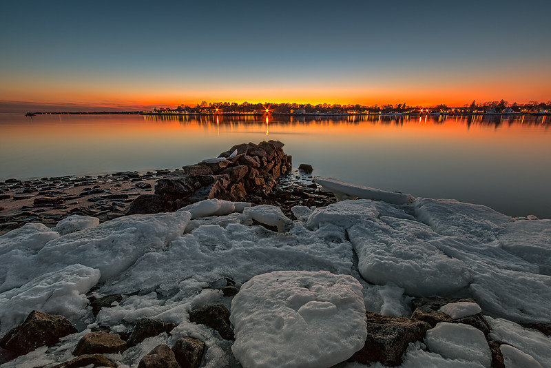 Sunset on the ice at Seaside Park in Bridgeport, Connecticut, USA.