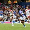 July 27, 2014 - Rugby Sevens - Samoa vs. England in the Quarter finals during the Rugby Sevens at the 20th Commonwealth Games in Glasgow, Scotland.<br /> <br /> Marcus Watson (#9) of England running after receiving a pass and rumming past Samoa Toloa (#12) of Samoa .<br /> <br /> Final score of the game was Samoa 15 and England 14.<br /> <br /> If you have any questions don't hesitate to reach out to us!<br /> <br /> Thanks!<br /> <br /> Photos by Al Milligan, Al Milligan Images, 2014