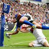 July 27, 2014 - Rugby Sevens - Samoa vs. England in the Quarter finals during the Rugby Sevens at the 20th Commonwealth Games in Glasgow, Scotland.<br /> <br /> Lio Lolo (#4) of Samona scoring a try during the 2nd half of the game <br /> <br /> Final score of the game was Samoa 15 and England 14.<br /> <br /> If you have any questions don't hesitate to reach out to us!<br /> <br /> Thanks!<br /> <br /> Photos by Al Milligan, Al Milligan Images, 2014