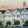 "Downtown San Francisco behind the ""Painted Ladies"" -- row of victorian houses on Alamo Square"