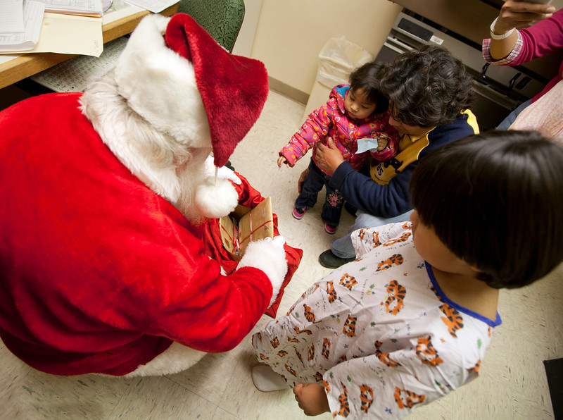5 year old Martin Aymara gets a present from Santa. Santa Clause visited the Pediatrics department of Holy Name Medical Center in Teaneck to give presents to the children. Photo by Jeff Rhode / Holy Name Medical Center 12/18/13