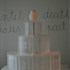Wedding cake topped with a grenade