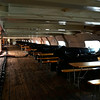 View down the length of the gun-deck -- 20 cannons, each with a table for crew of 9 men