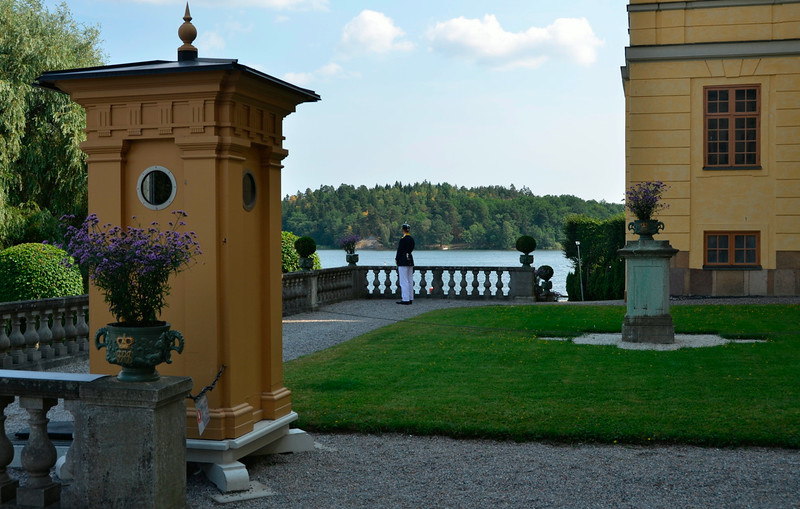 Guard posted at the wing of Drottningholm Palace where the royal family resides