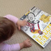 Scarlett reading the 2012 Tour de France guide magazine... like father, like daughter!