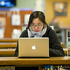 Maria Wei '17 studying in the library.