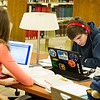 Garret Muckelroy '15 and Hannah Fiske '15 studying  in the library.