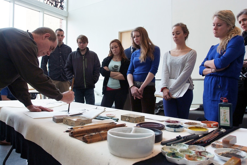 Michael Kopald '73 demonstrating Chinese brush painting for Associate Professor of Art History Melissa Kerin's Arts of China class.