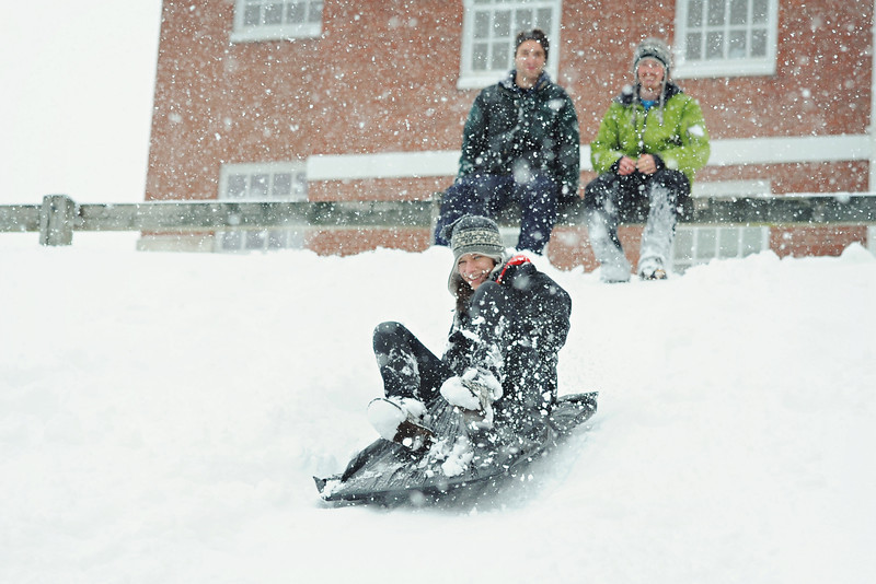 Students sledding behind the Science Center.