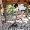 Becky Mickel '13 spreads mulch at Woods Creek Montessori School for Nabors Service Day.