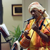Babukishan Das Baul performs traditional Indian music in the living room of Elrod Commons.