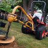 Facilities Management's Lead Grounds Worker Gabe Clark digging the hole for a new redbud tree on the Lee House lawn.