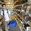 Erik Moctezuma '16 rounds up books for his first classes in the University Store.