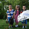 083109-1st day of 1st Grade LMA-holding up a sign