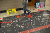 "A student walks on confetti-strewn floor following ""Brave"" video shoot at Souderton Area High School.   Wednesday, March 12, 2014.  Photo by Geoff Patton"