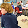 """Graham Hoyle answers questions during 7th grade literature class studying the book """"The Devil's Arithmetic"""" at the Broomfield Academy on Thursday.<br /> January 10, 2013<br /> staff photo/ David R. Jennings"""