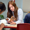 """Caitlin McFarlane, center, looks for an answer to a question in the 5th chapter in the book """"The Devil's Arithmetic"""" during 7th grade literature class at the Broomfield Academy on Thursday.<br /> January 10, 2013<br /> staff photo/ David R. Jennings"""