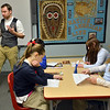"""Davis Turner, left, teaches the 7th grade literature class studying the book """"The Devil's Arithmetic"""" at the Broomfield Academy on Thursday.<br /> January 10, 2013<br /> staff photo/ David R. Jennings"""