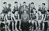 "One of the finest high school basketball teams to come out of Chadron -- ever!  This group of Archie Conn-coached Chadron Prep players not only won the State Class ""C"" Basketball Championship in the 1951-52 season, they were the only undefeated high school team in the state that year. Left-to-right: (sitting) Jim Hampton, Eddie Kuska, Larry Lytle, Coach Archie Conn, Charles Muma, Phil Williams, and Jim Palmer; (standing) Frank Clark, Jim Neeland, Student Manager Bill Ewen, Bob Buchanan, and Pete Woods."