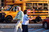 Jr ROTC chief  Doris Sullivan directs traffic on first morning of school at North Penn HIgh School.   At left is principal Burton Hynes Tuesday, September 2, 2014.   Photo by Geoff Patton