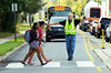 Jim Musselman stops traffic on Elroy Road as Pennfield Middle School students cross on their way to first day of classes.   Tuesday, September 2, 2014.   Photo by Geoff Patton