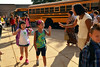Principal D'Ana Waters welcomes students as they get off buses on first day of school at Hatield Elementary School.    Tuesday,  September 2, 2014.  Photo by Geoff Patton