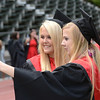 José Quezada — For the Times-Standard<br /> <br /> Lacey Anderson and Shelby Smith take a selfie minutes before graduating.<br /> <br /> McKinleyville High School conducted it's 51st Commencement ceremony Thursday at Humboldt State's Redwood Bowl Thursday afternoon.
